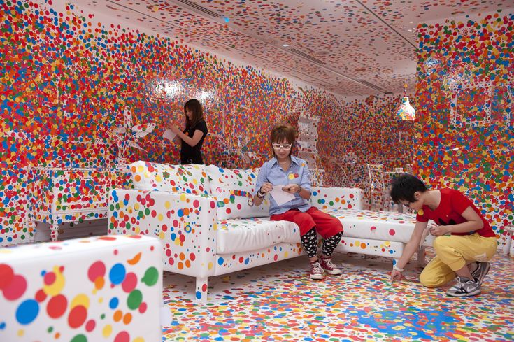yayoi kusama dot art - The Obliteration Room - a white room decorated with more and more round stickers