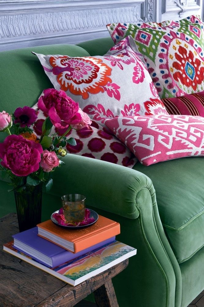 Soft green velvet lounge with colourful suzani cushions, via Pinterest