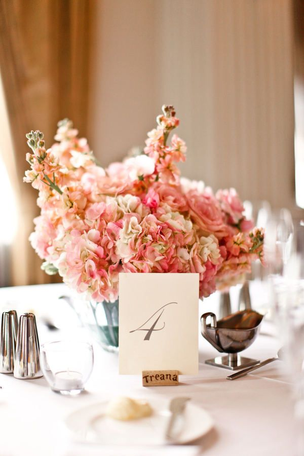 love the flowers and the wine cork as the table number holders