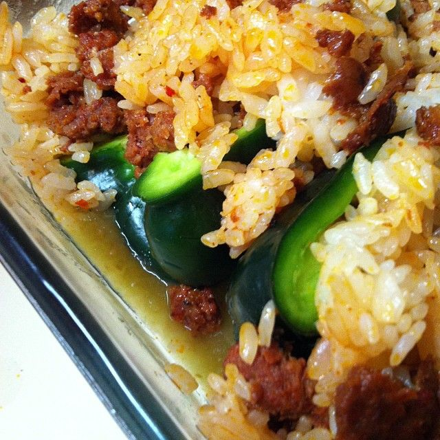 Poblano peppers stuffed with rice and chorizo in green salsa