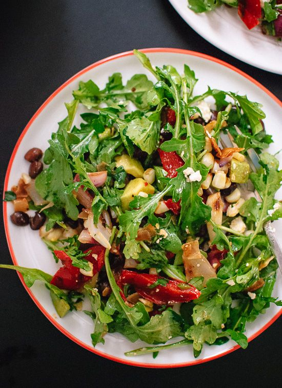Vegetarian grilled summer salad with fresh arugula, black beans and ...