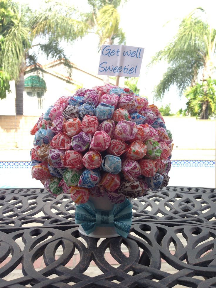 ... dum dums into the foam ball forming a ball of lollipops. Wrap ribbon