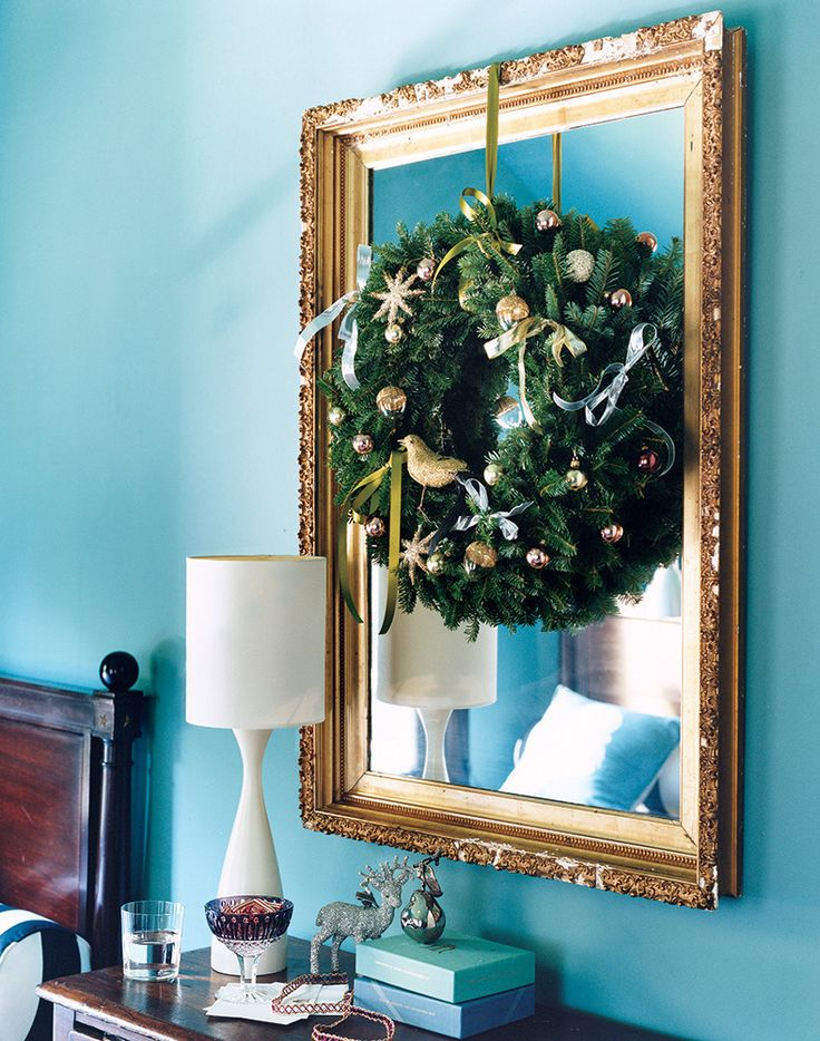 Wreath on a mirror for a festive touch. unique holiday decorating ideas on domino.com