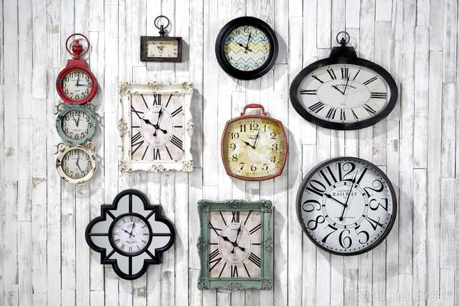 i like this arrangement of wall clocks home decor