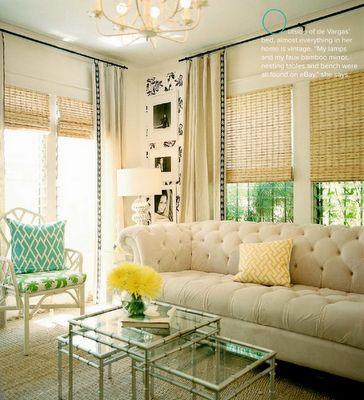 bamboo shades and curtains behind sofa