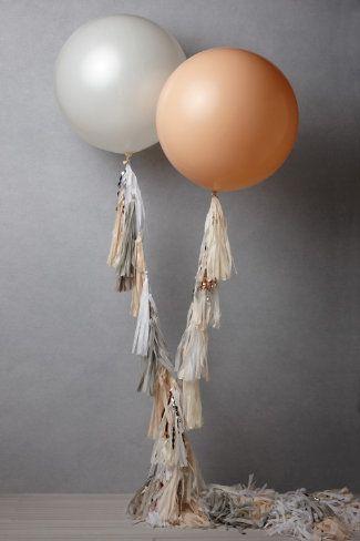 Peach, cream balloons with tassel ribbons
