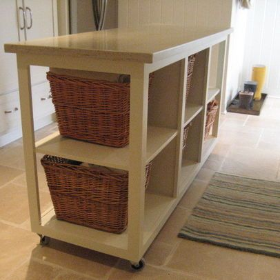 Laundry Folding Table with a basket for each persons folded laundry ...