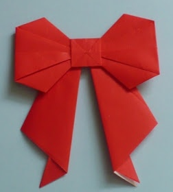 Create paper bow tutorial fold and create origami pinter