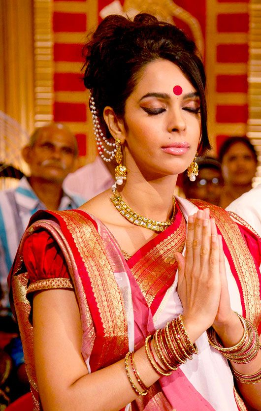 mallika sherawat wearing traditional bengali saree and jewellery