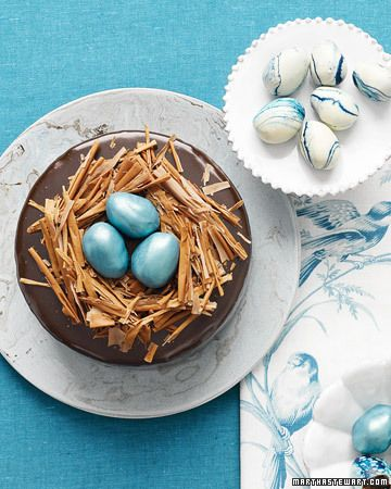 Rich Chocolate Cake with Truffle-Egg Nest  Tucked inside nests of milk-chocolate shavings are truffle eggs tinted robin's egg blue and dusted with metallic luster. The accompanying marbled eggs are created by dipping more truffles into melted white chocolate swirled with blue food coloring.