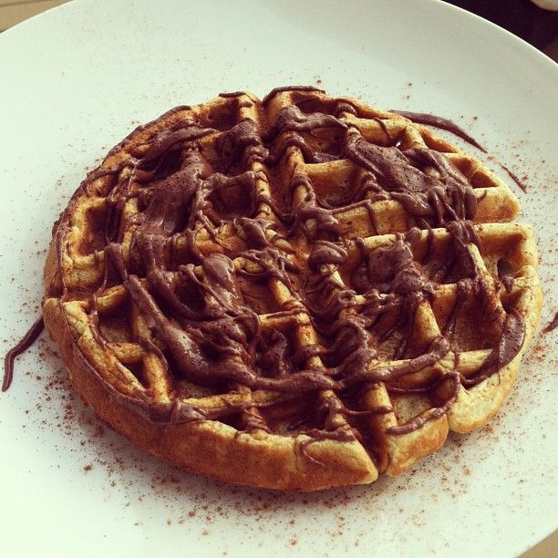 waffle (banana, egg, 1/2 cup oats) topped with melted dark chocolate ...