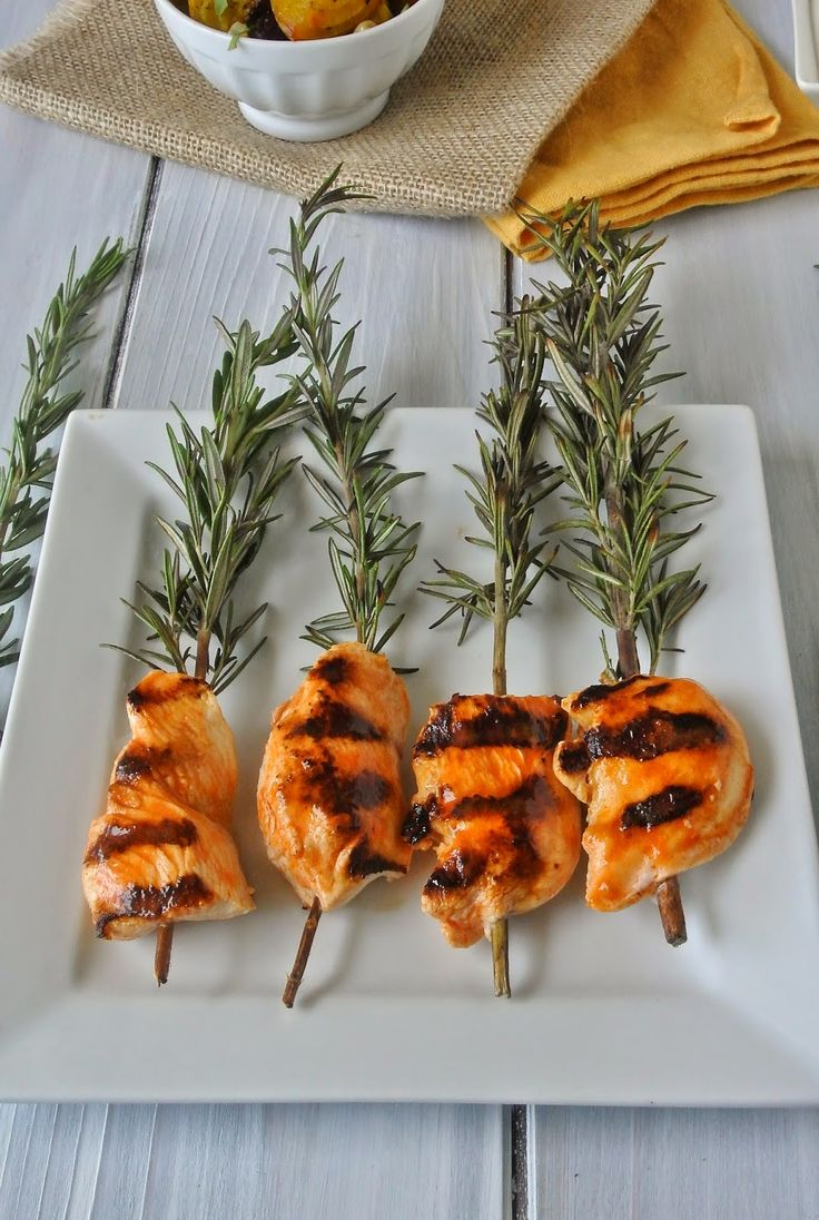 Buffalo rosemary chicken skewers with blue cheese sauce.