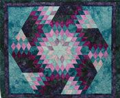 "Spinning Diamonds - Strip sets are cut then placed together so the diamonds spin in a hexagon around the quilt top. This design only looks complicated when you follow the techniques that Kaye Wood has developed. Uses the Starmaker® 6 (sold separately).  Size: 54"" x 47""  http://www.kayewood.com/item/Spinning_Diamonds_Pattern/262 $8.00"