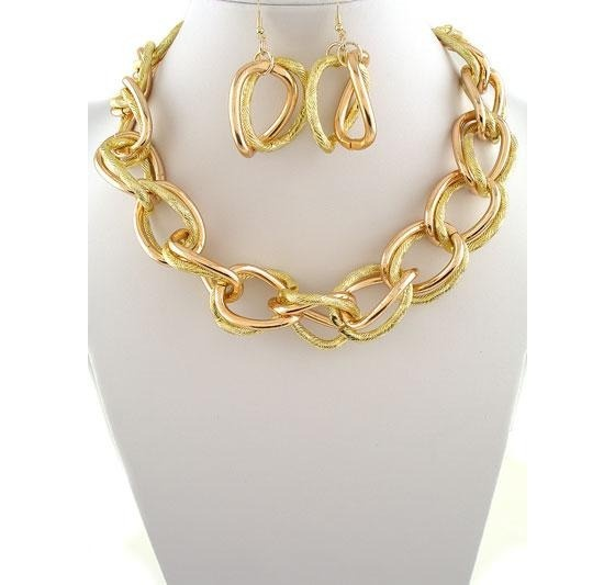 Gold and copper chain link necklace and earrings. We're thinking a nautical pairing would be perfect.