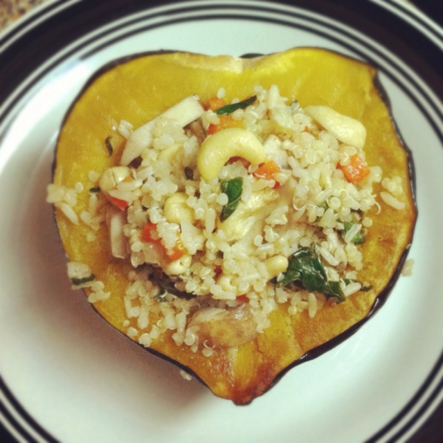 Roasted acorn squash stuffed with quinoa, mushroom, red pepper ...