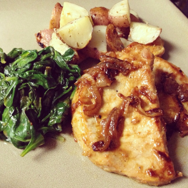 ... with Caramelized onions, roasted garlic potatoes and sautéed spinach
