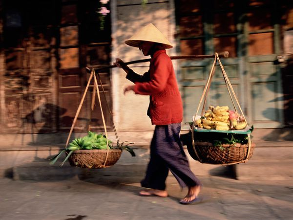 Vietnam. The iconic hat, on  a street peddler.