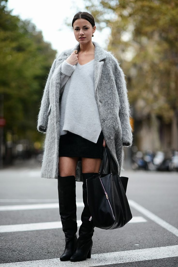 long boots, mini skirt, grey winter coat and black handbag