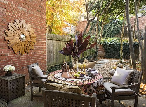 A wood patio set can esily be dressed up with a showstopping tablecloth..