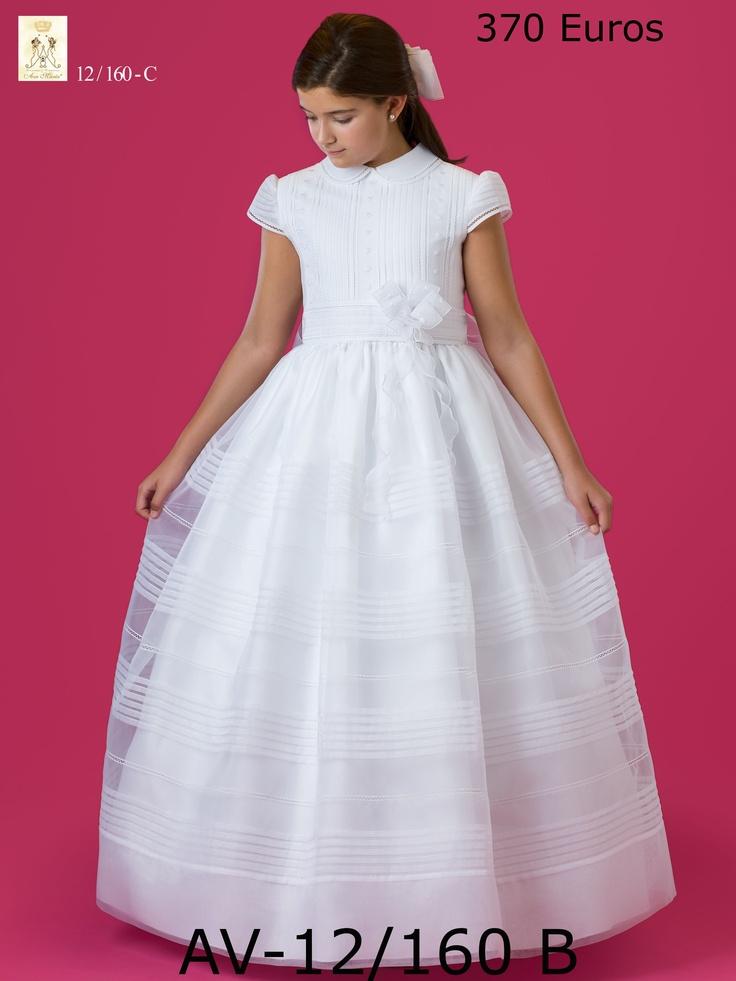 Vestido de Organza Blanca, línea clásico, cuello bebé y jaretitas, entredoses de topos bordados  370€ en todas las tallas y medidas en Novias Cira