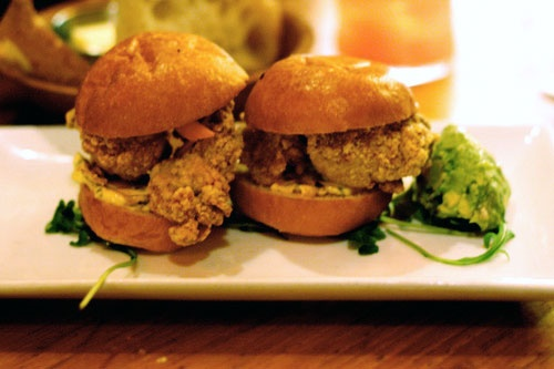 crab cake po-boy: 1 baguette, 1 slice of bacon, 2 fried green tomatoes ...