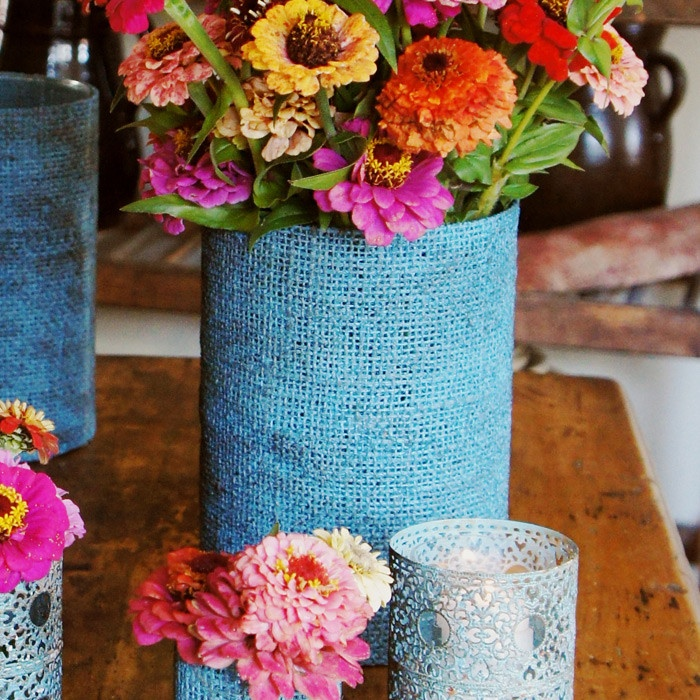 Spray paint burlap cloth/doilies/lace and glue around glass or cans for DIY vases and votive holders.