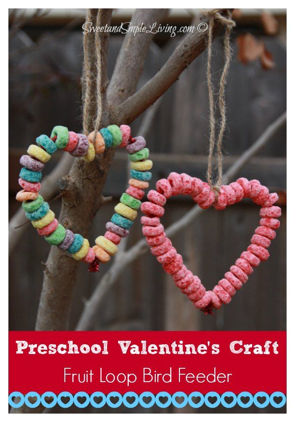 Super easy craft perfect for the little ones. Preschool Valentine Crafts Fruit Loop Bird Feeder from SweetandSimpleLiving.com #easycrafts