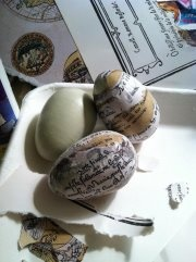 Decoupaging eggs with torn text