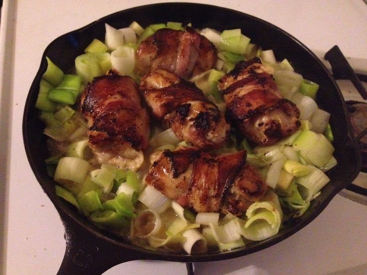 Bacon wrapped chicken thighs braised in leeks