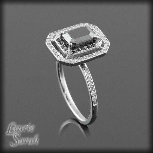 Cut black diamond engagement ring with black and white diamond