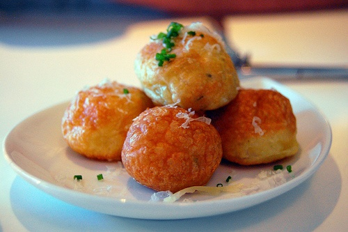 Warm gougeres (French cheese puffs) with chives