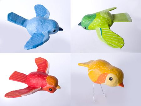 Paper mache birds using several techniques on each bird