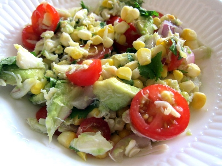 Salad includes a mix of avocado, tomatoes, corn, crab meat, red onions ...