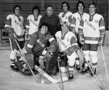 """I love today's """"Photo of the Day."""" It's of the 1973-74 freshmen along with Bob Johnson. Five out of seven NHL draft picks, three NHL players, three guys named Dave, one current NHL broadcaster, and one currently the VP of Hockey Operations for the Anaheim Ducks. I don't know what the rest are doing these days. Anyone? Back Row - L to R: Dave Lundeen, Dave Otness, Bob Johnson, Pete Scamurra, Steve Clippingdale, Jim Jefferies. Front - Goalie Dave McNab, Brian Engblom."""