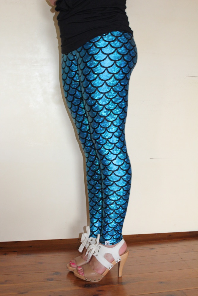 ... these!!! How hot with a little black sweater dress! MERMAID leggings