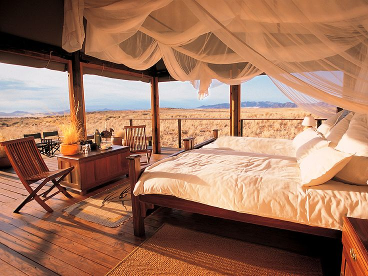 Africa |  Wolwedans, NamibRand Nature Reserve. Namibia is another amazing country, with beautiful deserts and one can spend time in a beautiful lodge which is open sided, with views of sand dunes surrounding one, or perhaps a skylight so one can view the stars. The piece de resistance is taking a hot air balloon ride over the dunes at dawn as the dunes change hue!