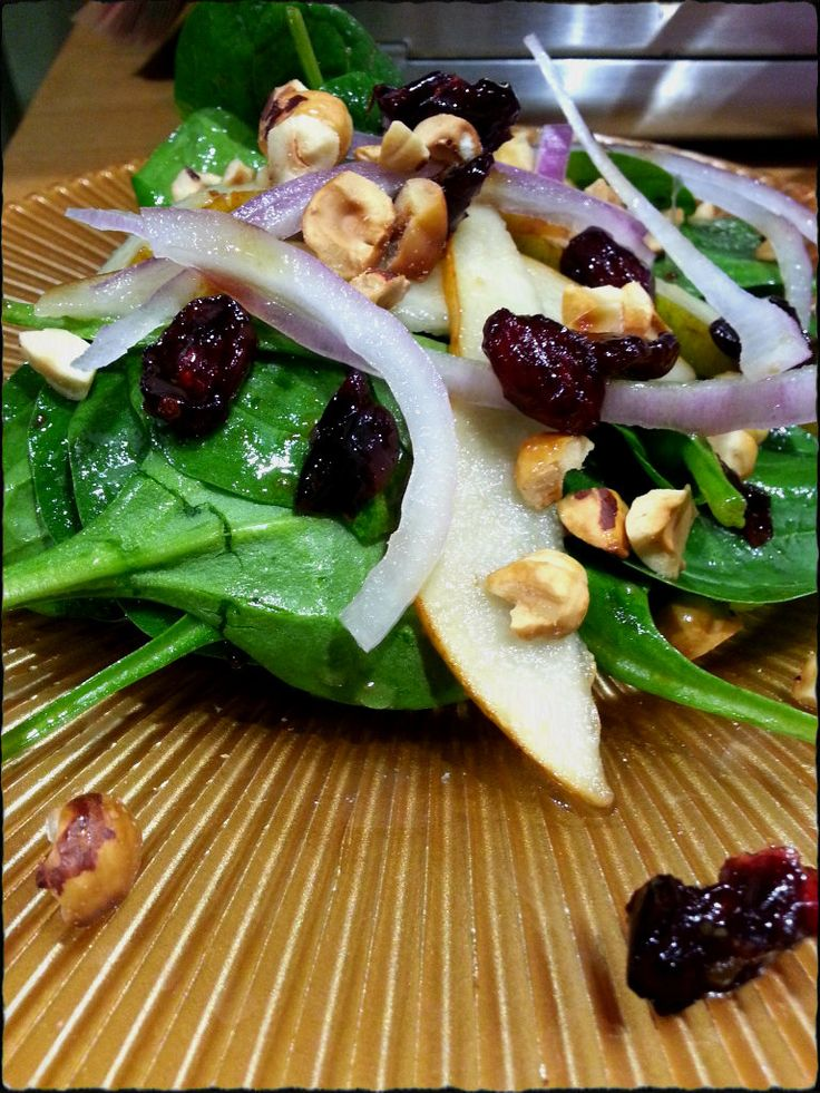 Baby Spinach Salad With Pears, Red Onions, Cranberries And Toasted ...