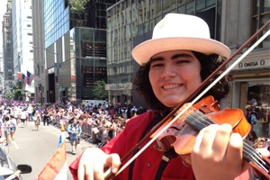 13 year old puertorican boy, Alejandro Manuel, playing the violin at the Puerto Rico parade in New York.