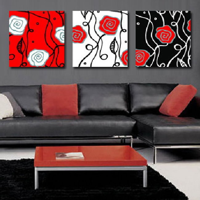 red, white, black flower print wall hangings.