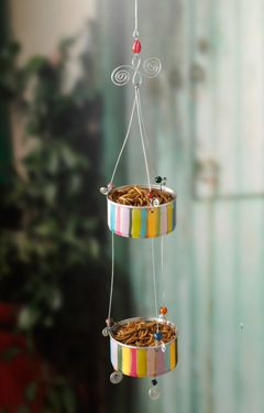 Upcycle 2 empty tuna or cat food tins into a cheery bluebird feeder.