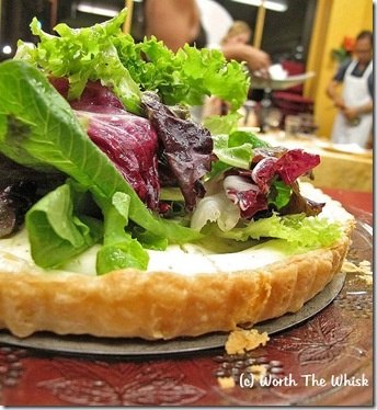 Thyme and goat cheese tart topped with mixed greens tossed in champagne vinaigrette.  Lovely starter