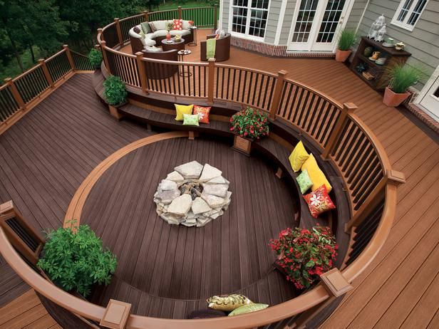 Forever home deck. deck with built in seating and fire pit.