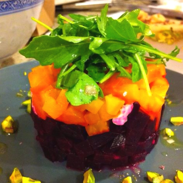 Homemade roast beet salad with goat cheese, arugula, and pistachios