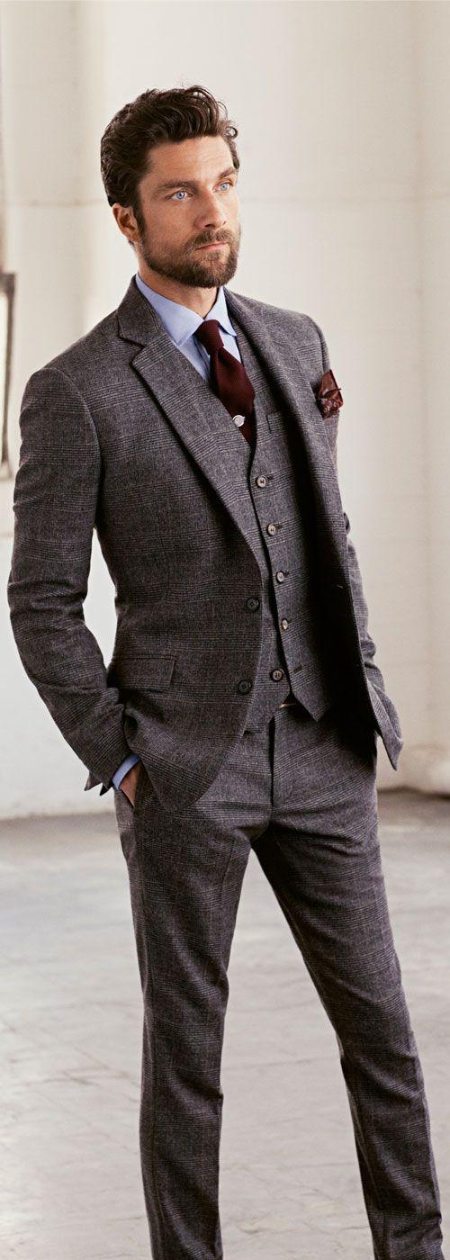 Tweed suit. Burgundy accessories.
