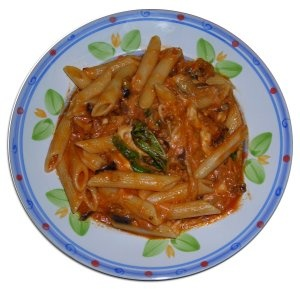 Pasta alla norma with eggplants, mozzarella cheese and tomato sauce