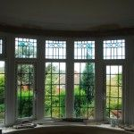 Replica 1920s style windows in new frame house for 1920s window styles