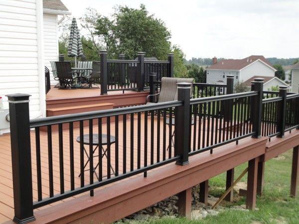 Deck color black on brown garden outside living for Garden decking colours