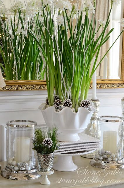 Paperwhites with silver and mercury glass, along with sprayed twigs and pinecones.  So pretty.. Via StoneGable