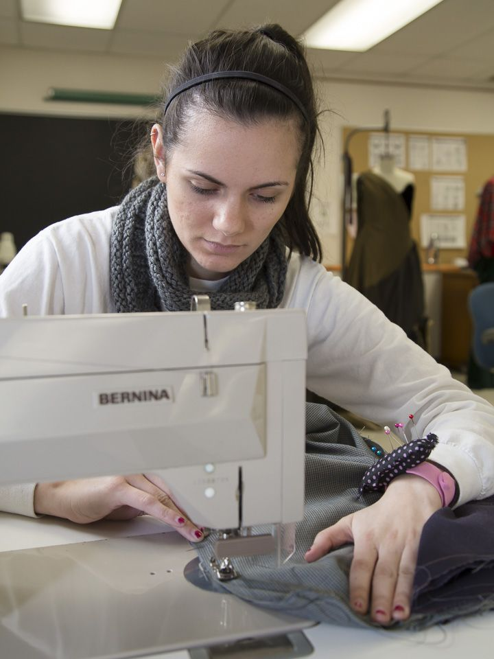 Courtney Francis A Junior Fashion Design Major Works On A Pair Of Business