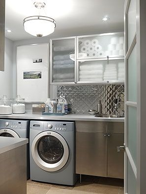 Loving the use of cookie jars for detergent, the linen/TP storage, the white board, cleaning products...all brilliant.